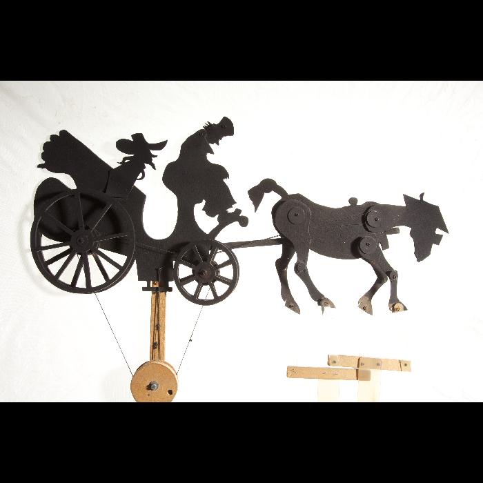 Voiture à cheval avec personnages, silhouette de théâtre d'ombres russe. Collection de Jacques Chesnais.