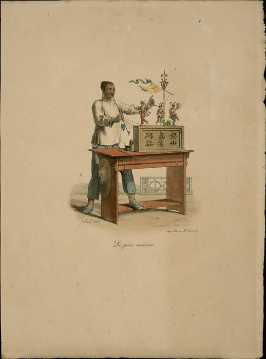 La Pièce curieuse. Chinois manipulant des marionnettes sur table.